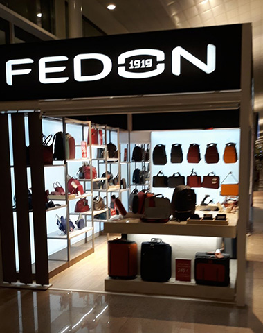Building with fabric: the new Fedon stores in the airports of Madrid and Barcelona